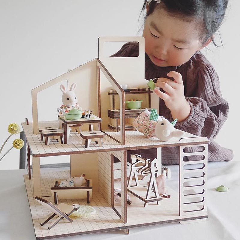 Modern wood dollhouse with matching furniture.