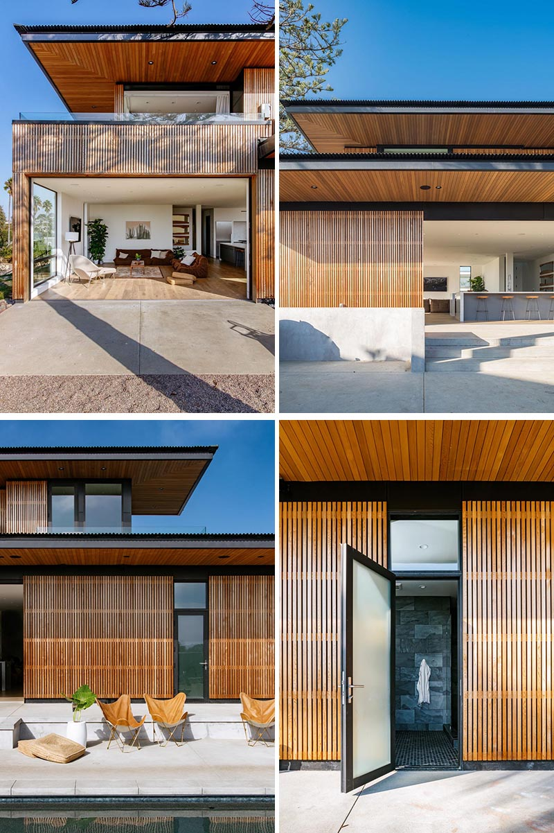 A house with wood slat siding opens up to to outdoor spaces and is accented by black details like the window frames.
