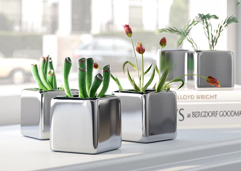 A set of mini cube succulent pots with a sleek metallic finish.