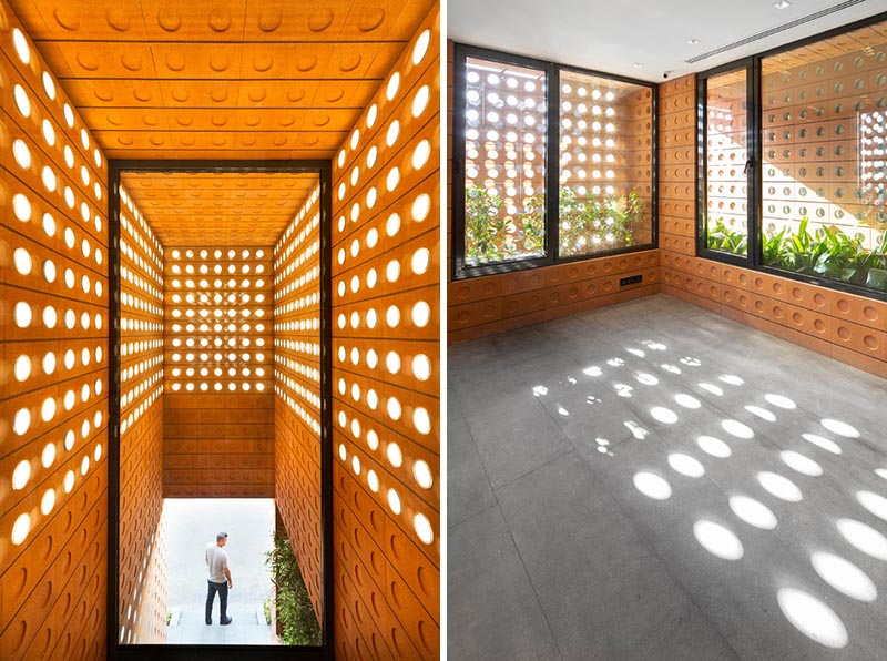 Custom modern bricks with small round windows shine light though to the interior of the building.