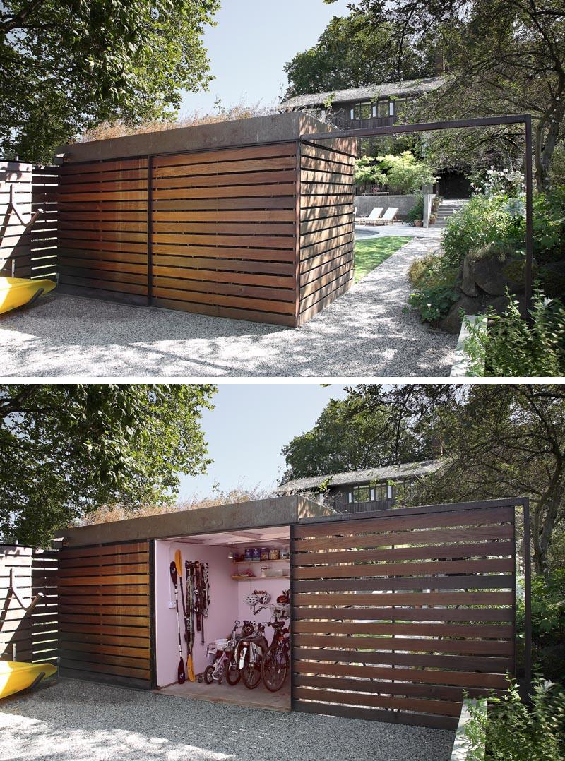 A modern backyard shed that hides a bike storage room behind a sliding door.
