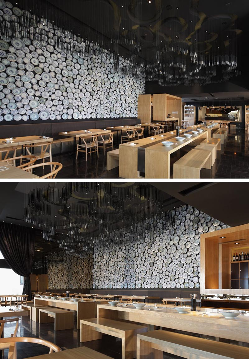 An entire wall within this modern restaurant has been covered in traditional noodle bowls to create an eye-catching accent wall.