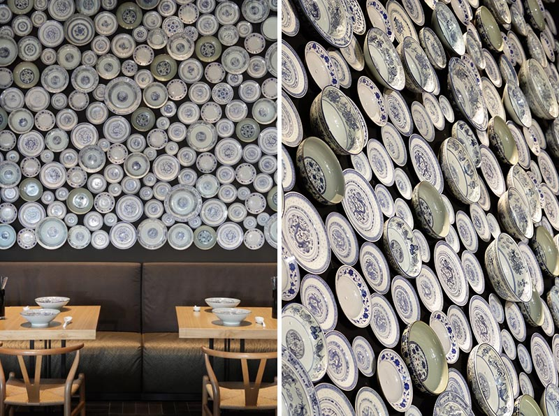A modern restaurant with an accent wall made from traditional noodle bowls and plates.
