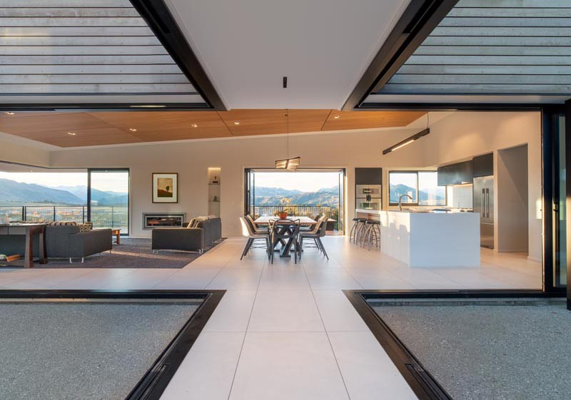 Retractable glass walls connect this New Zealand house with the outdoors.