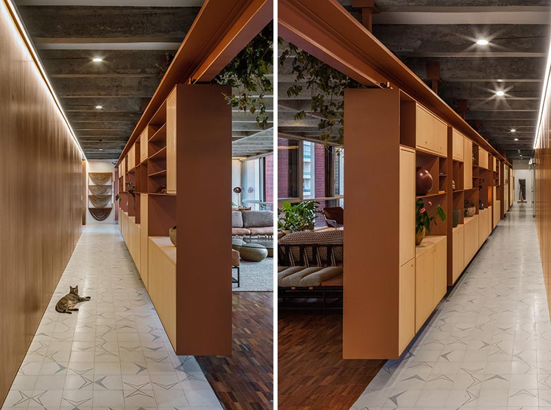 Wood and steel shelving that hangs from rails can be moved depending on the requirements of the home owner.
