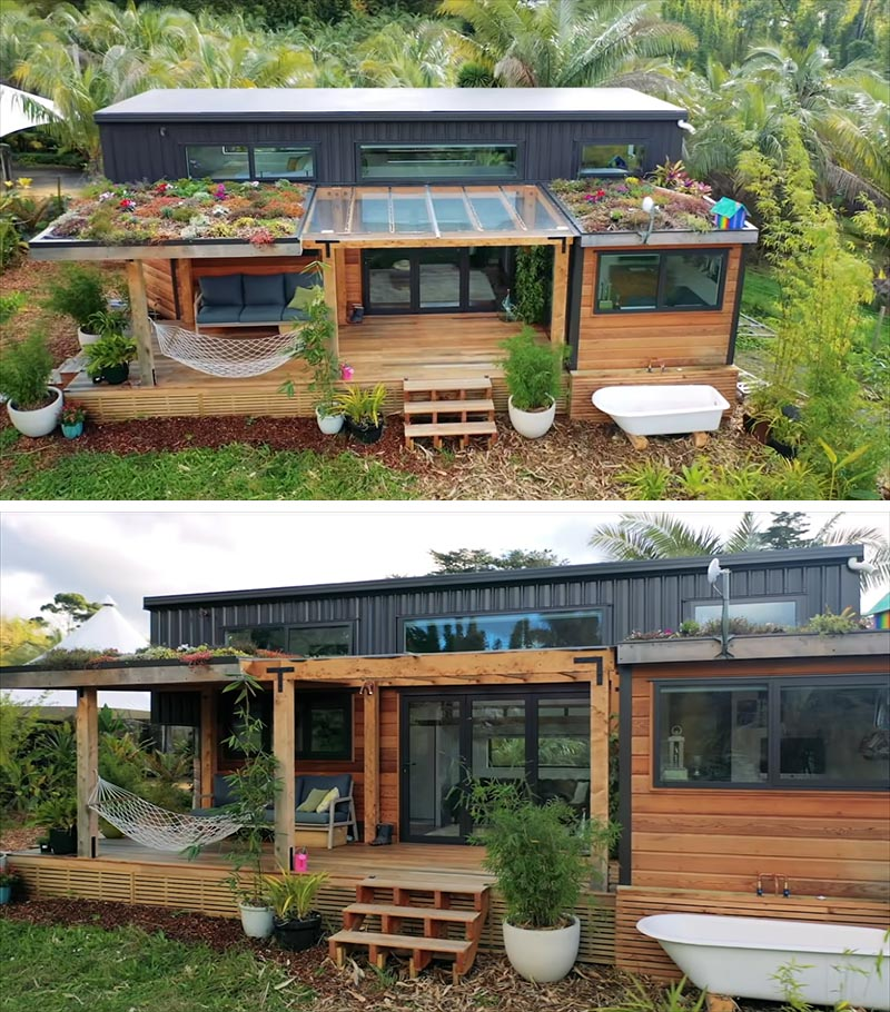 A modern tiny house with a porch and green roofs, that uses cedar siding and colored steel for the exterior materials.