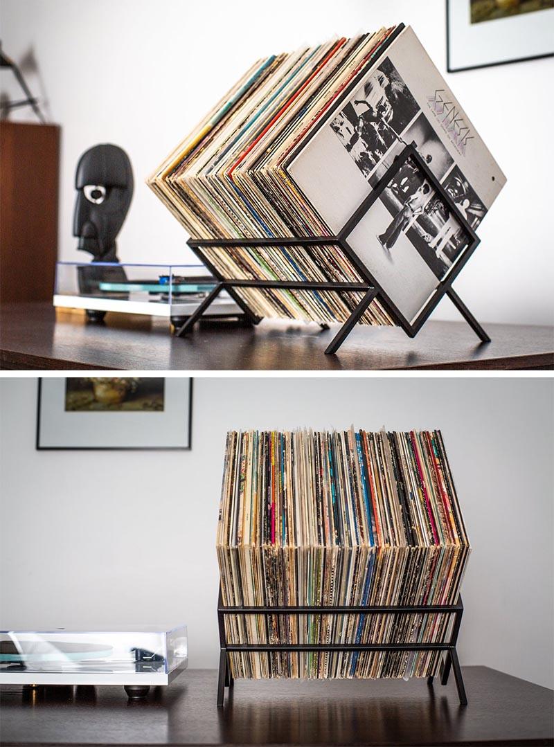 Minimalist vinyl record storage cube made from black metal.