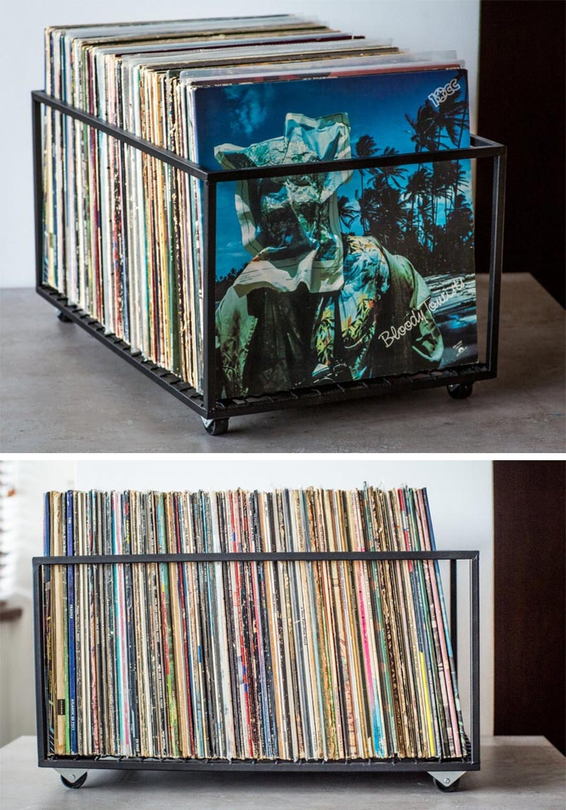A minimalist black metal cube with wheels for storing vinyl records.