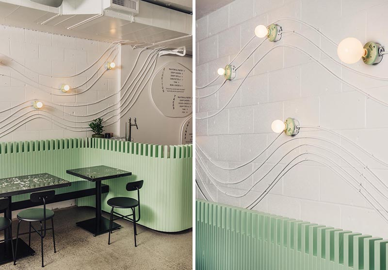 Electrical conduit was used to create wave-like wall art in this restaurant design.
