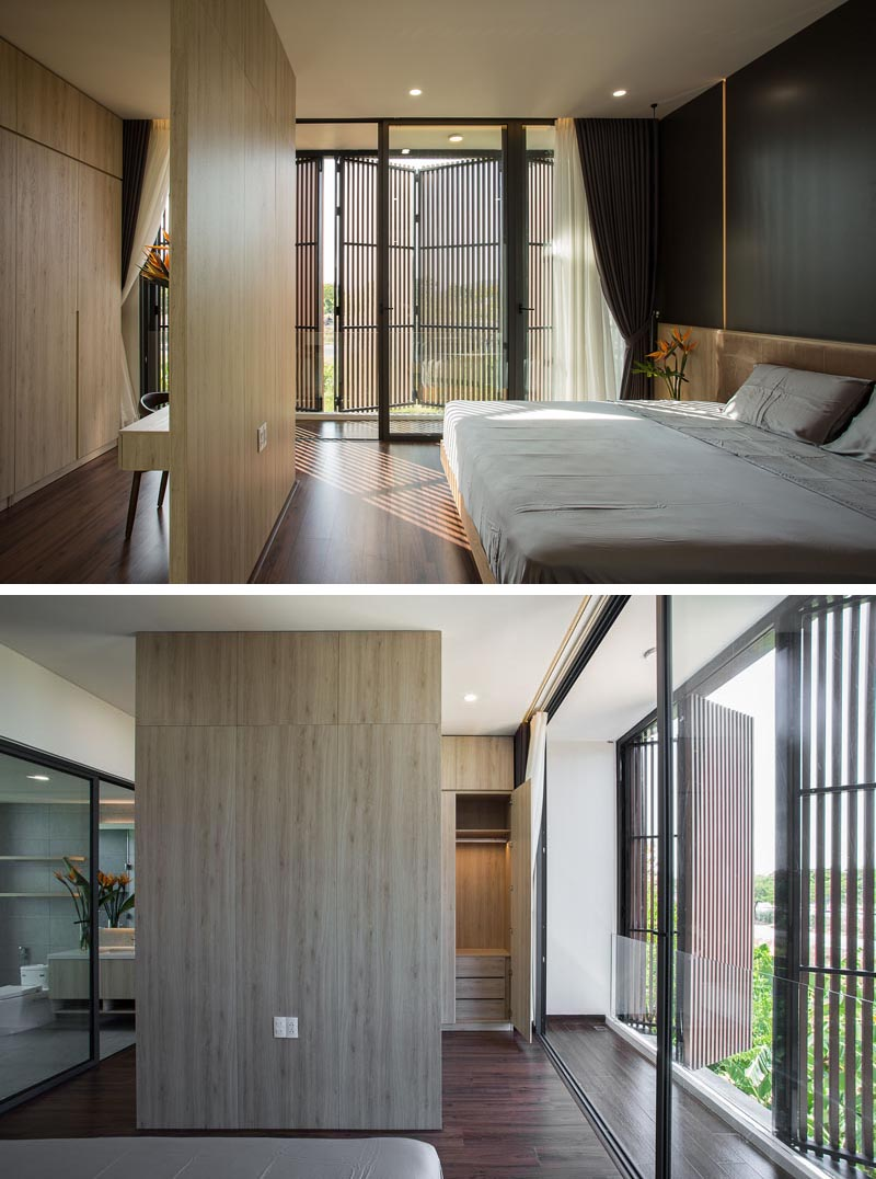 A wood room divider separates the sleeping area in the bedroom from the closet.