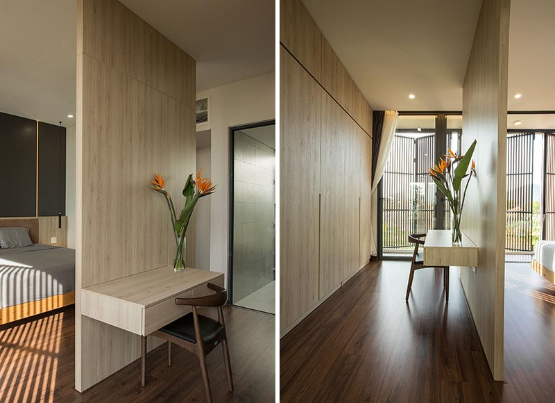 A bedroom room divider creates a space for a floating desk.