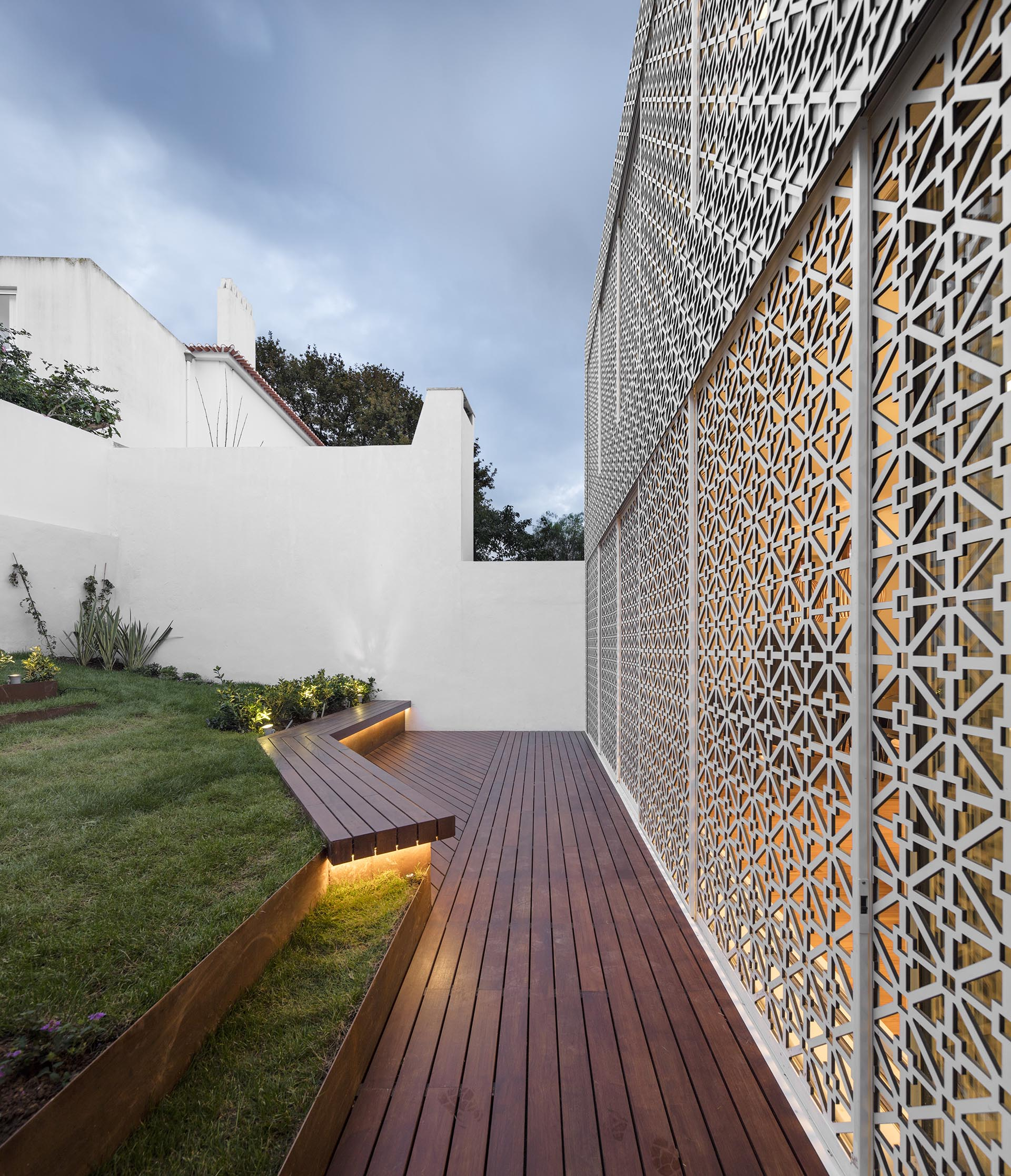 Sliding screens with a decorative pattern open this house to the backyard.