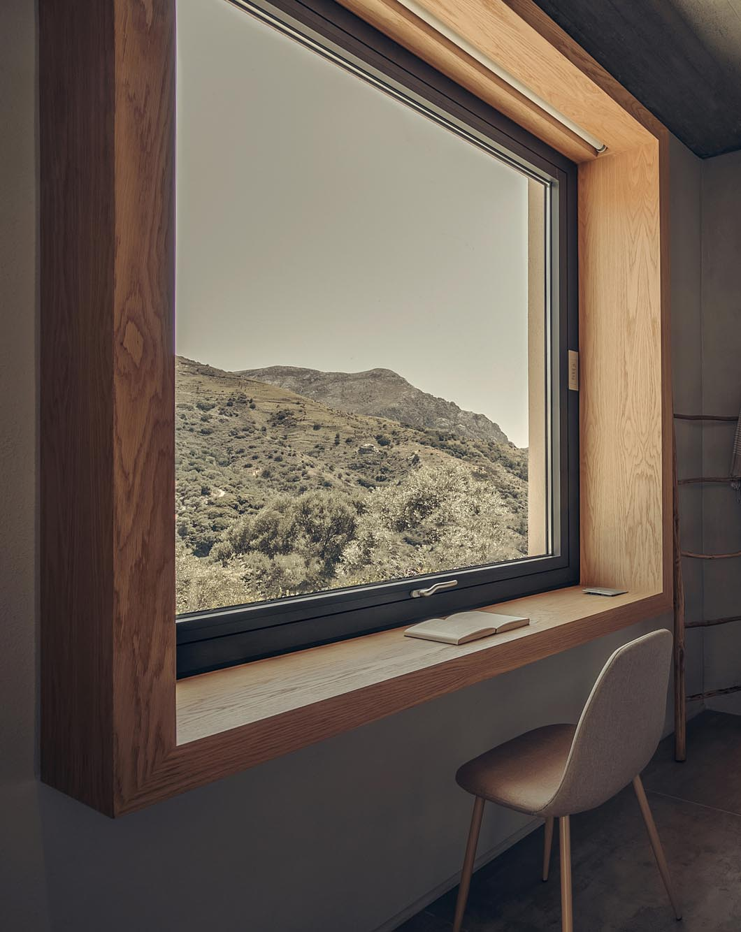A deep wood window frame that can be used as a desk.
