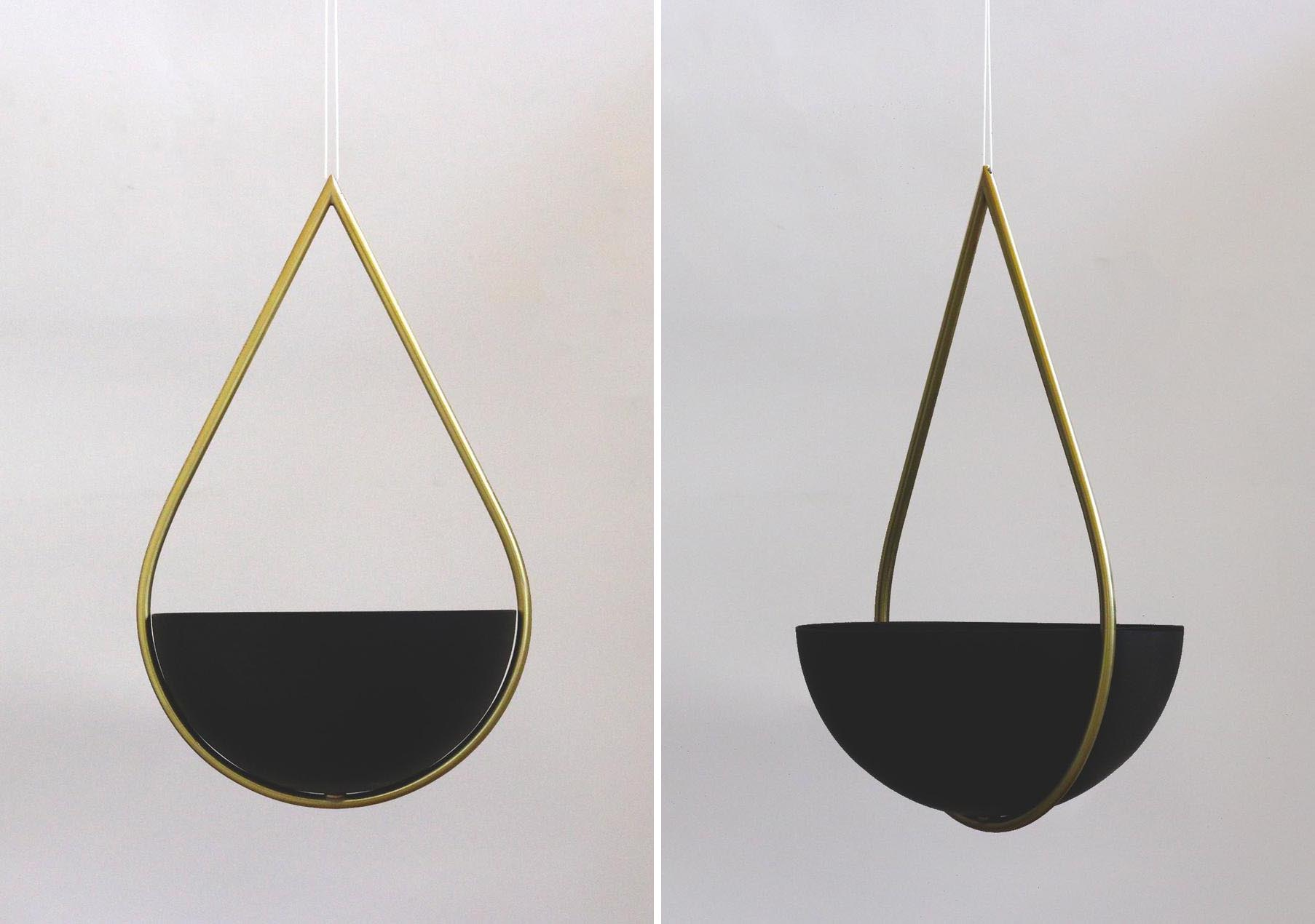 A hanging planter with a brass and matte black finish.