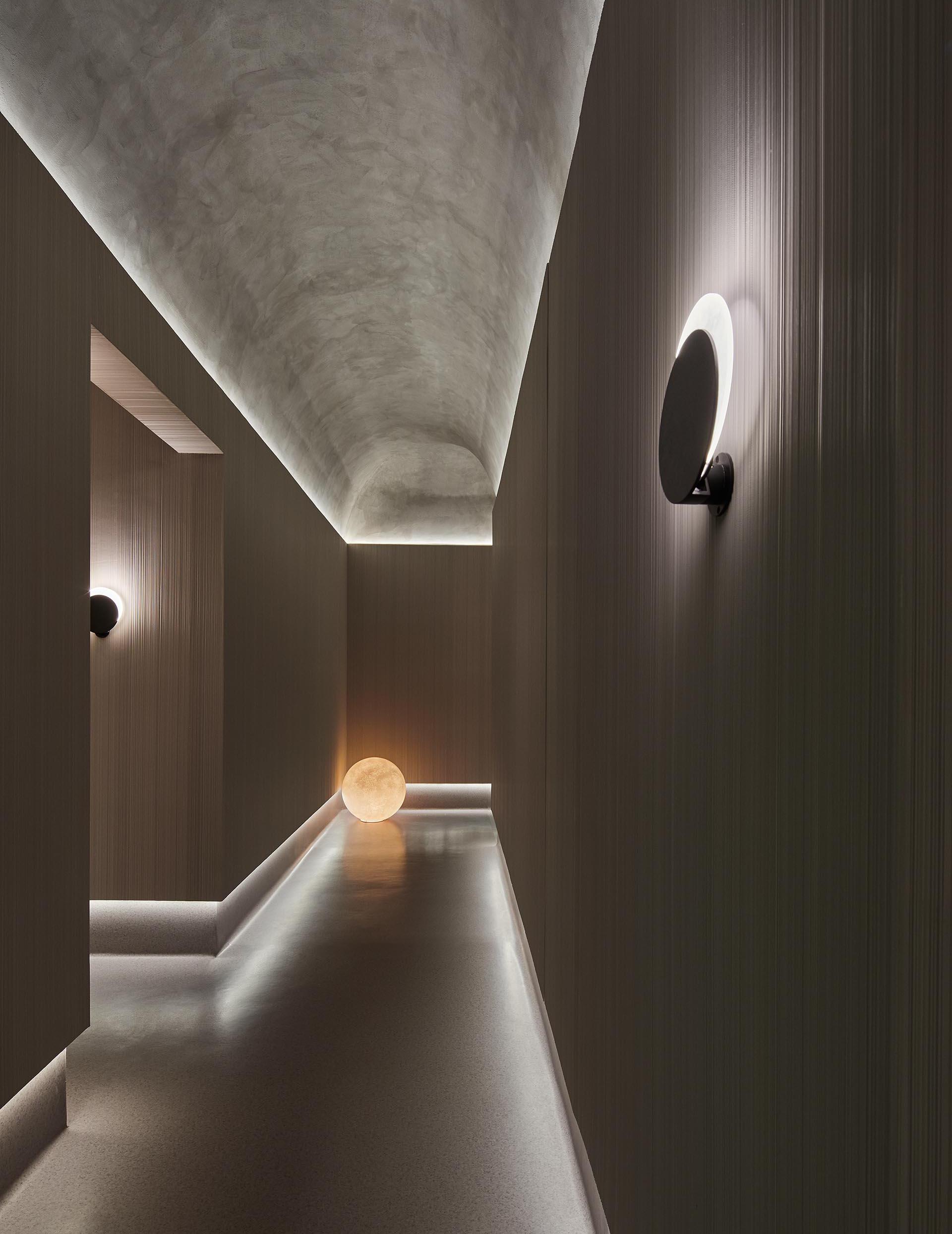 Hidden lighting lines the ceiling and floor in this hallway.