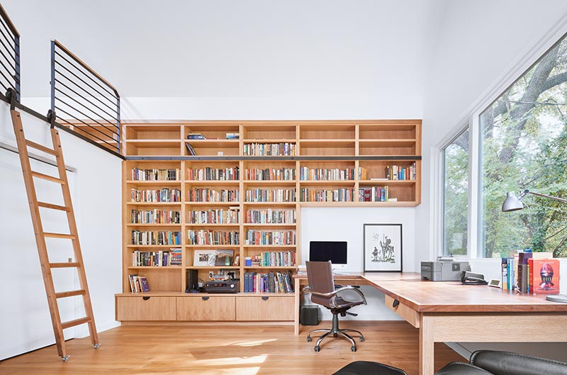 A home office used as a writer's studio also doubles as a guest suite with a lofted sleeping area.