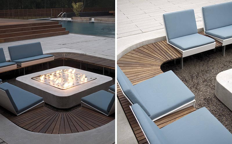 A modern outdoor conversation pit has a square shape that's lined with custom seating surrounding a fireplace.