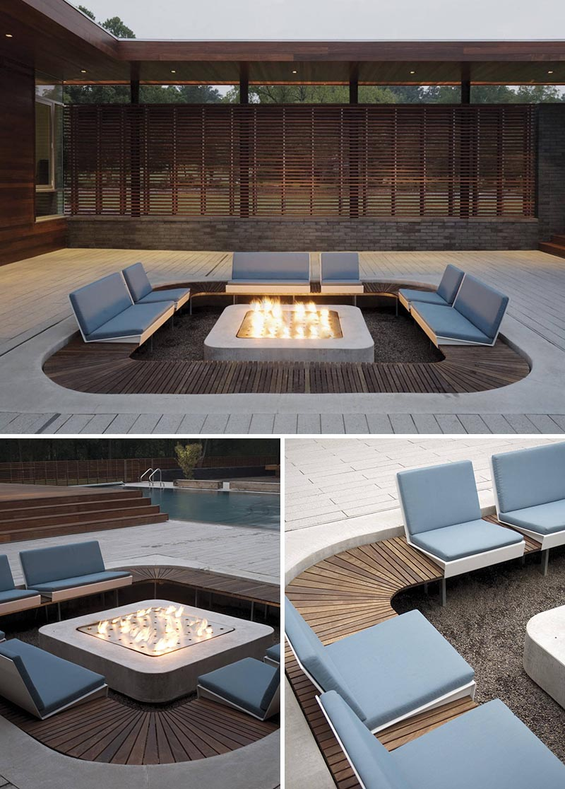 A modern outdoor conversation pit with custom seating that's focused on the fire.