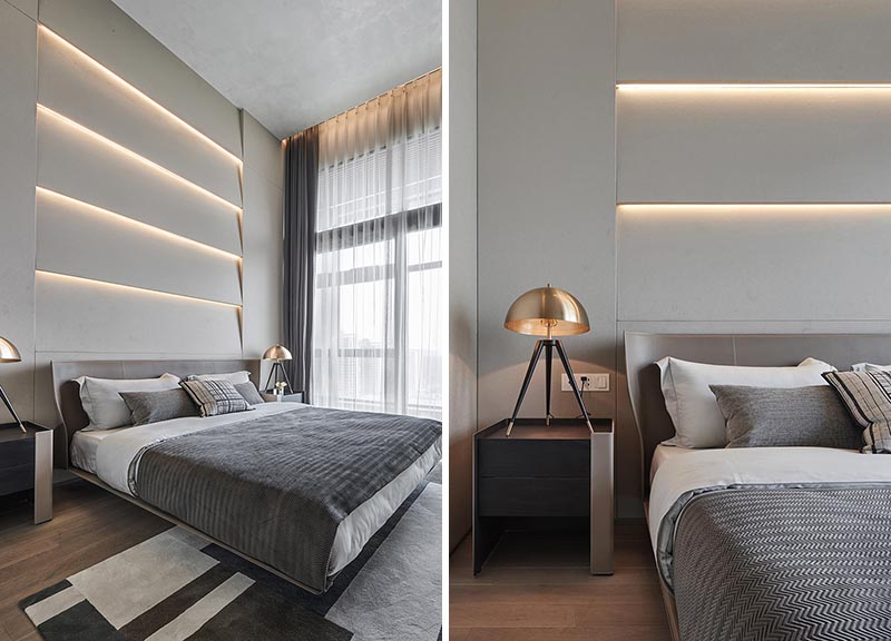 A bedroom accent wall with angled sections and hidden lighting.