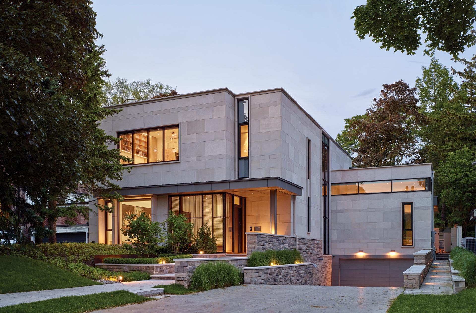 A modern house that features a limestone exterior.
