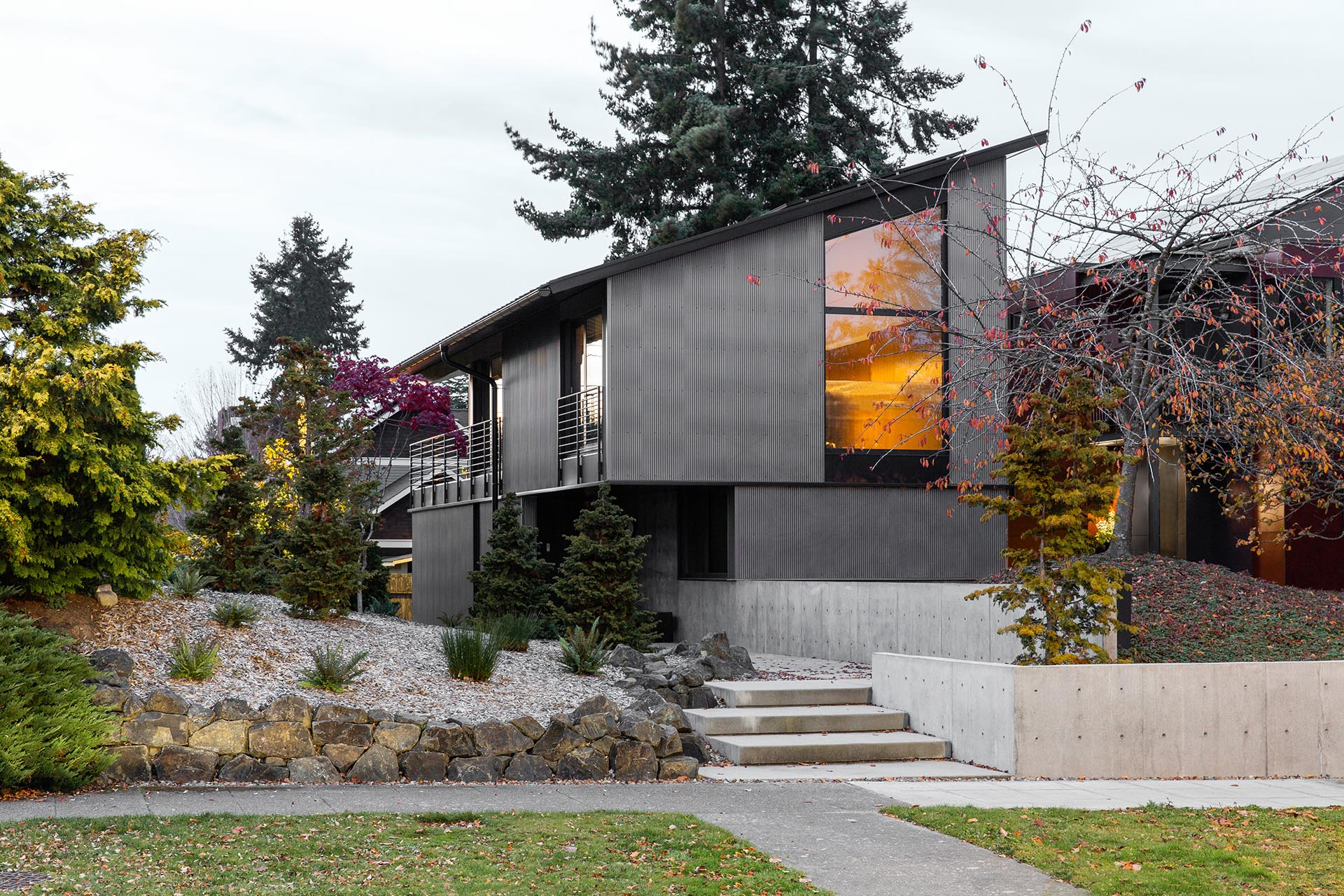 A shed roof and metal siding create a modern house.