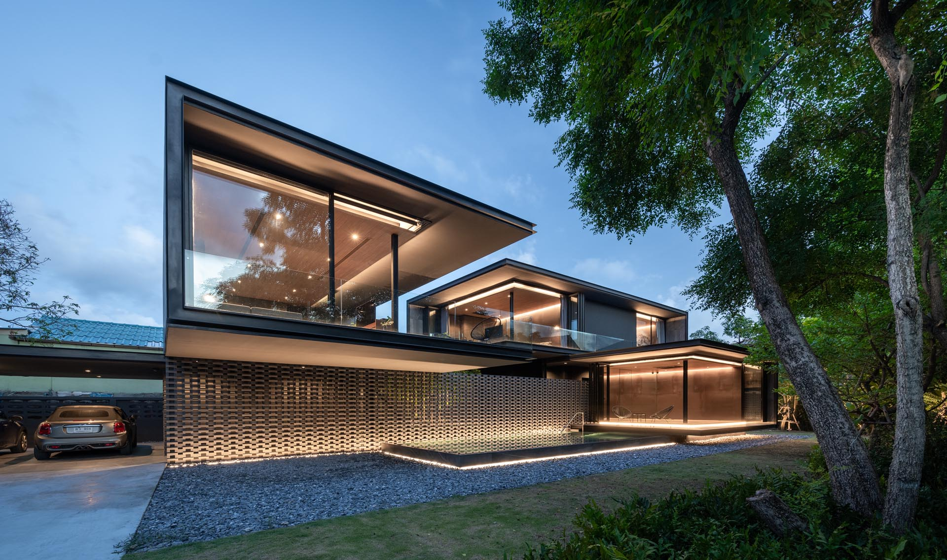 Lighting has been used to highlight the lines of this modern house.