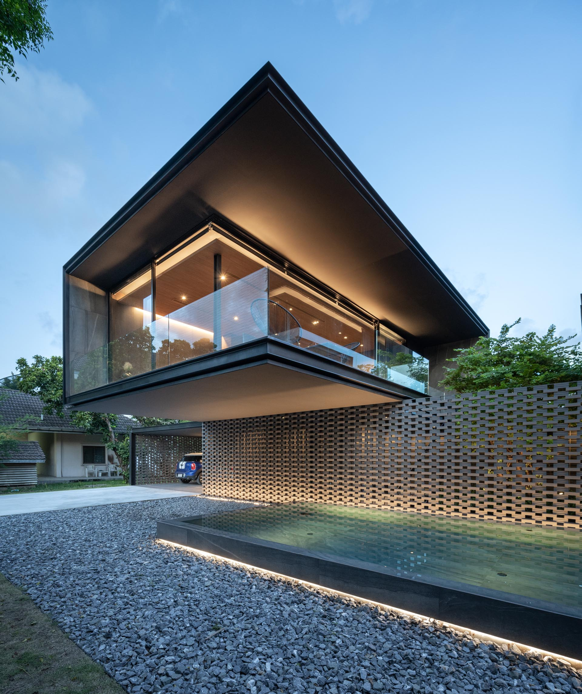 Lighting has been used to highlight the horizontal lights of this house design.
