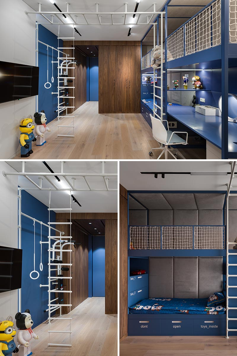 A modern kids bedroom that includes a climbing gym, a built-in bed, storage, a homework station, and a lofted play space.