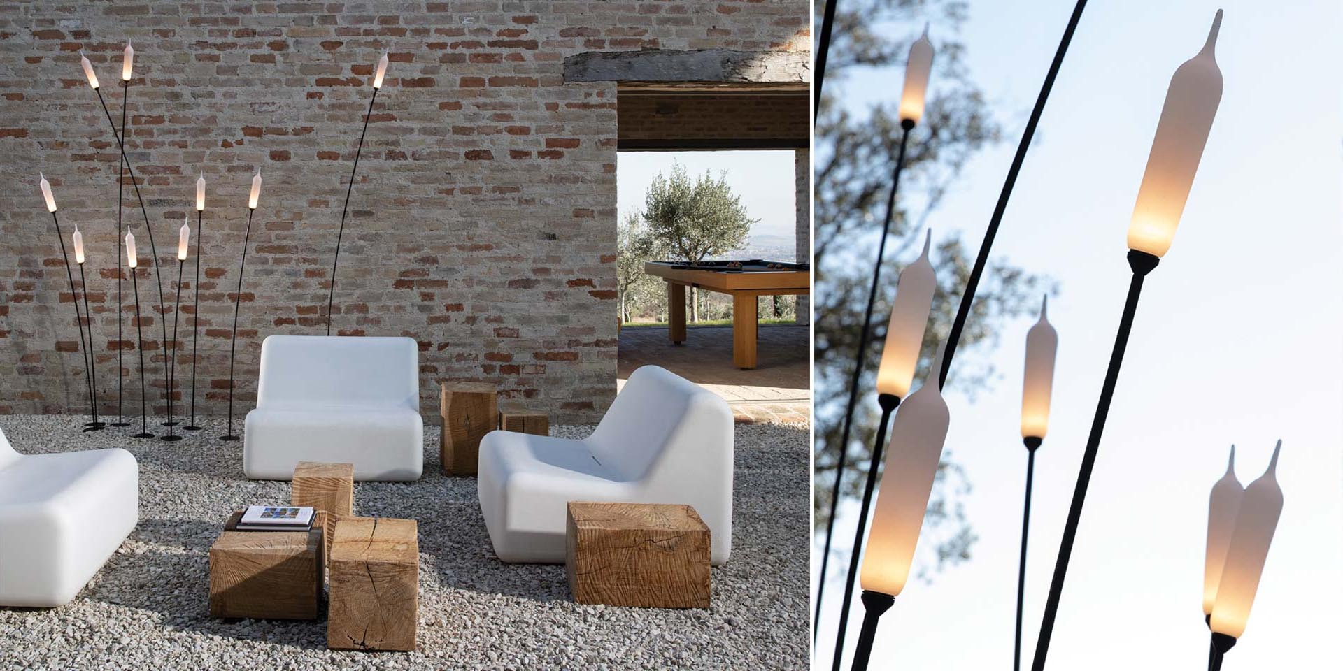 Modern outdoor lighting that looks like bulrush or cattail plants.