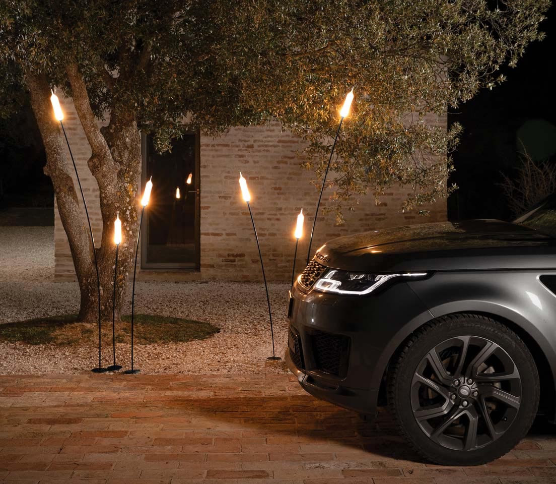Modern outdoor lighting that looks like plants.
