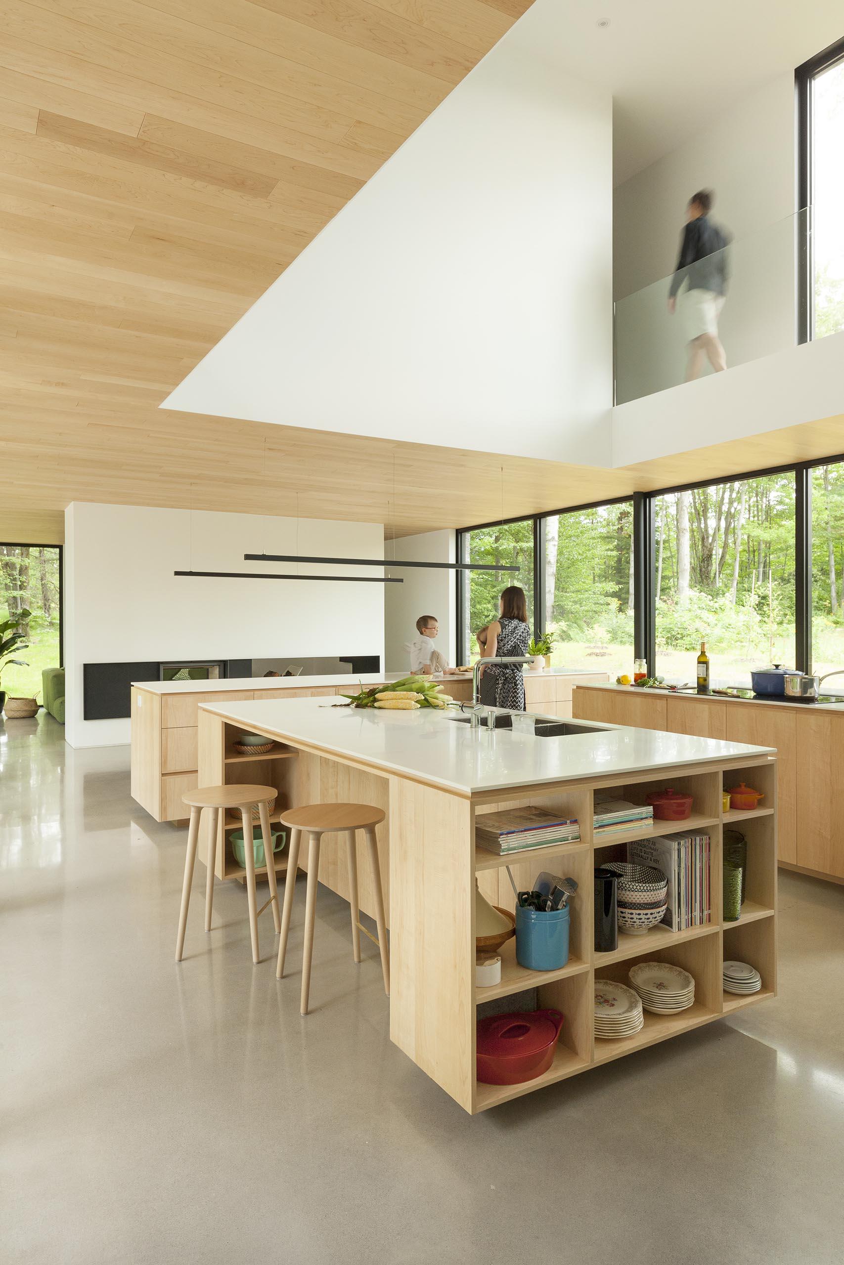 A modern kitchen with three islands that provide plenty of storage.