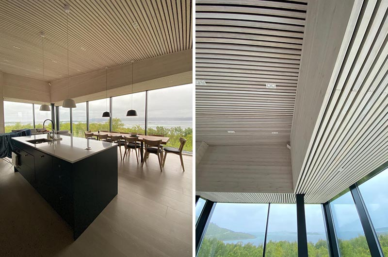 A modern house interior with wood slat ceiling.