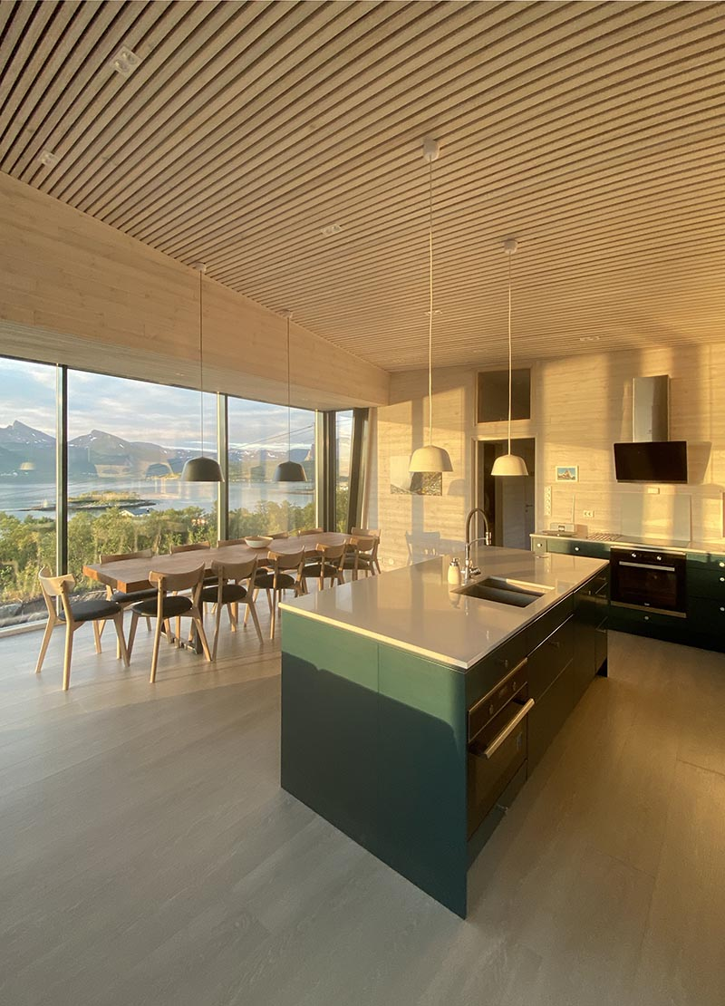 Wood slat ceilings draw the eye upwards to appreciate the high ceilings and the textured design element.