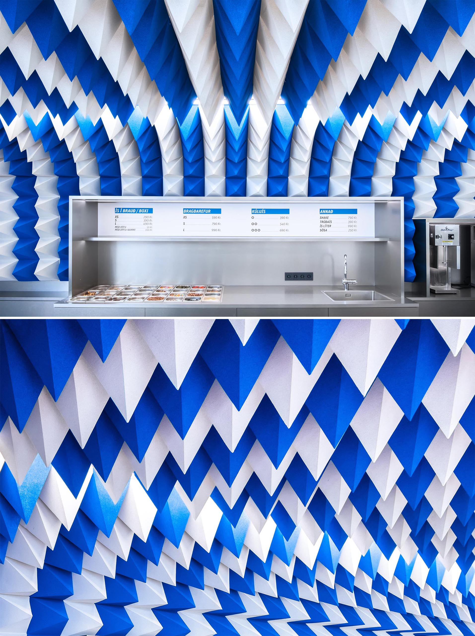 A modern ice cream store with a sculptural ceiling installation made from blue and white foam pyramids.