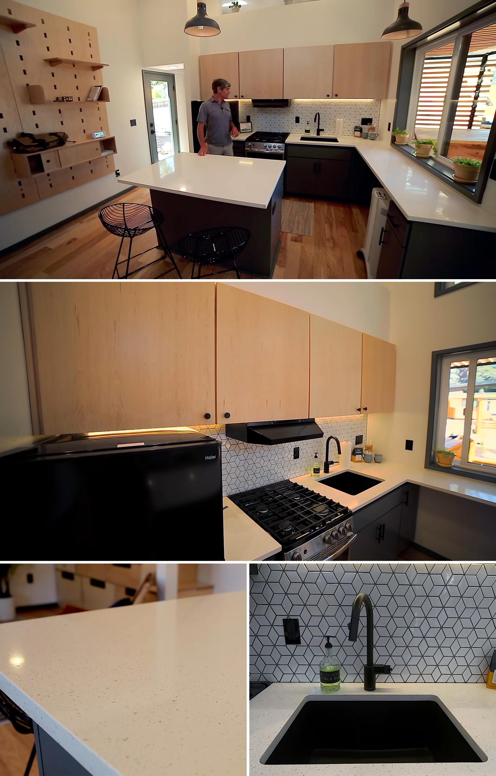 A tiny house kitchen with quartz countertops, 24 inch appliances, counter space, and a large black sink.