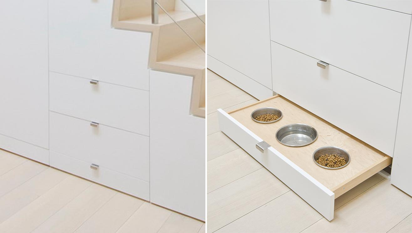 Under stair storage includes a pull-out pet food bowl drawer.