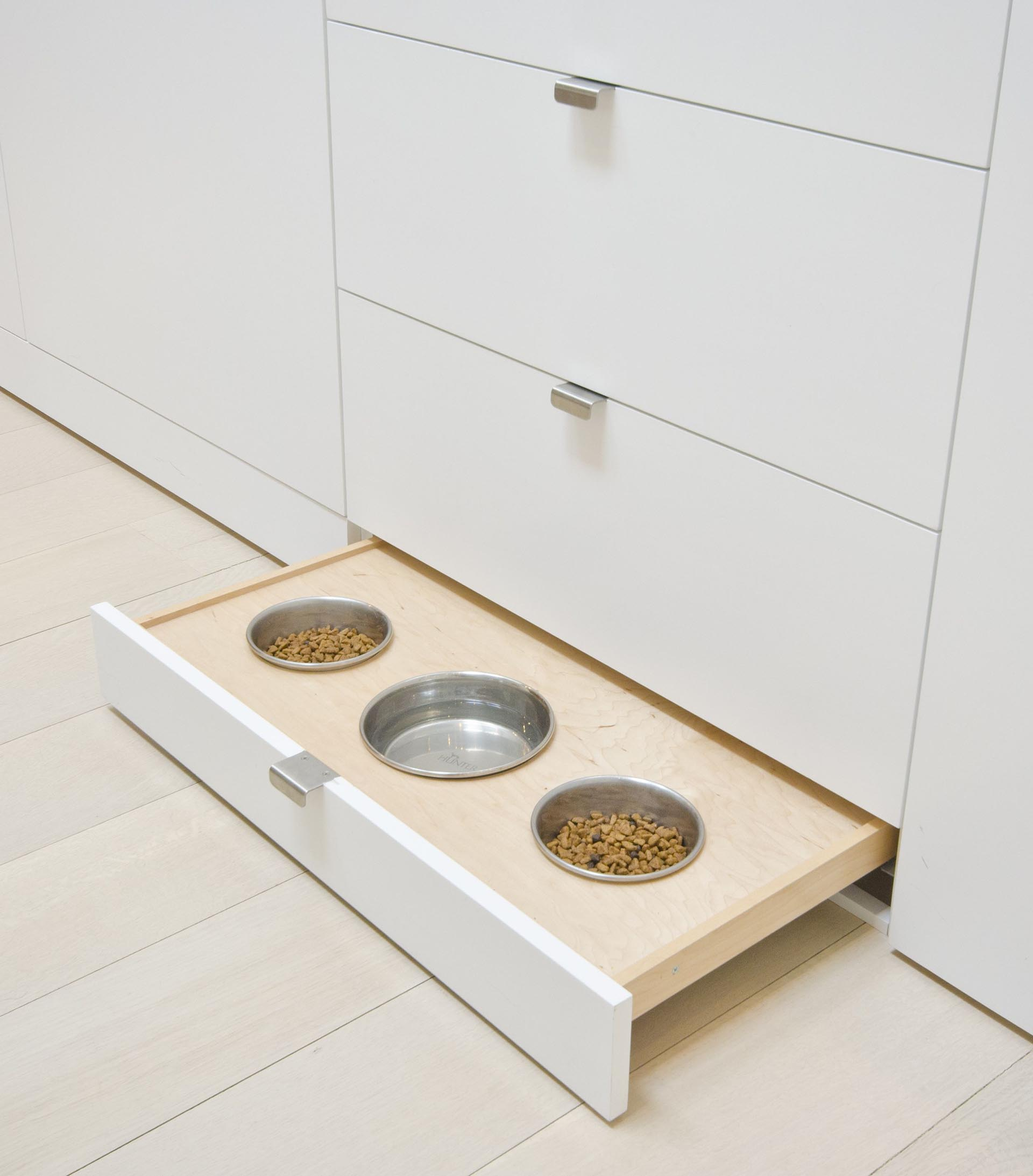 Hidden pet foot bowls located in a pullout drawer makes it easy to hide when not in use.