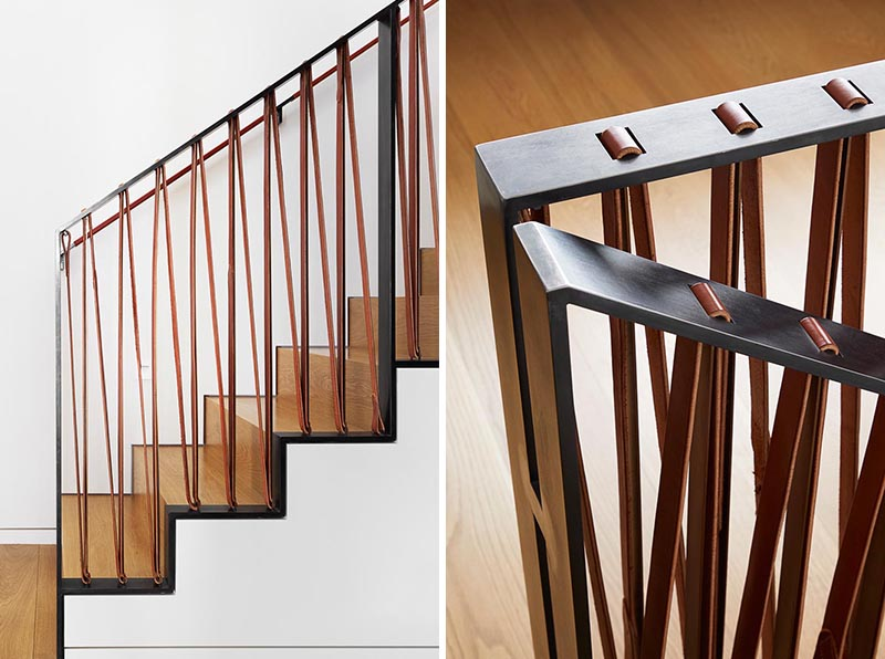 A black steel and leather stair railing.