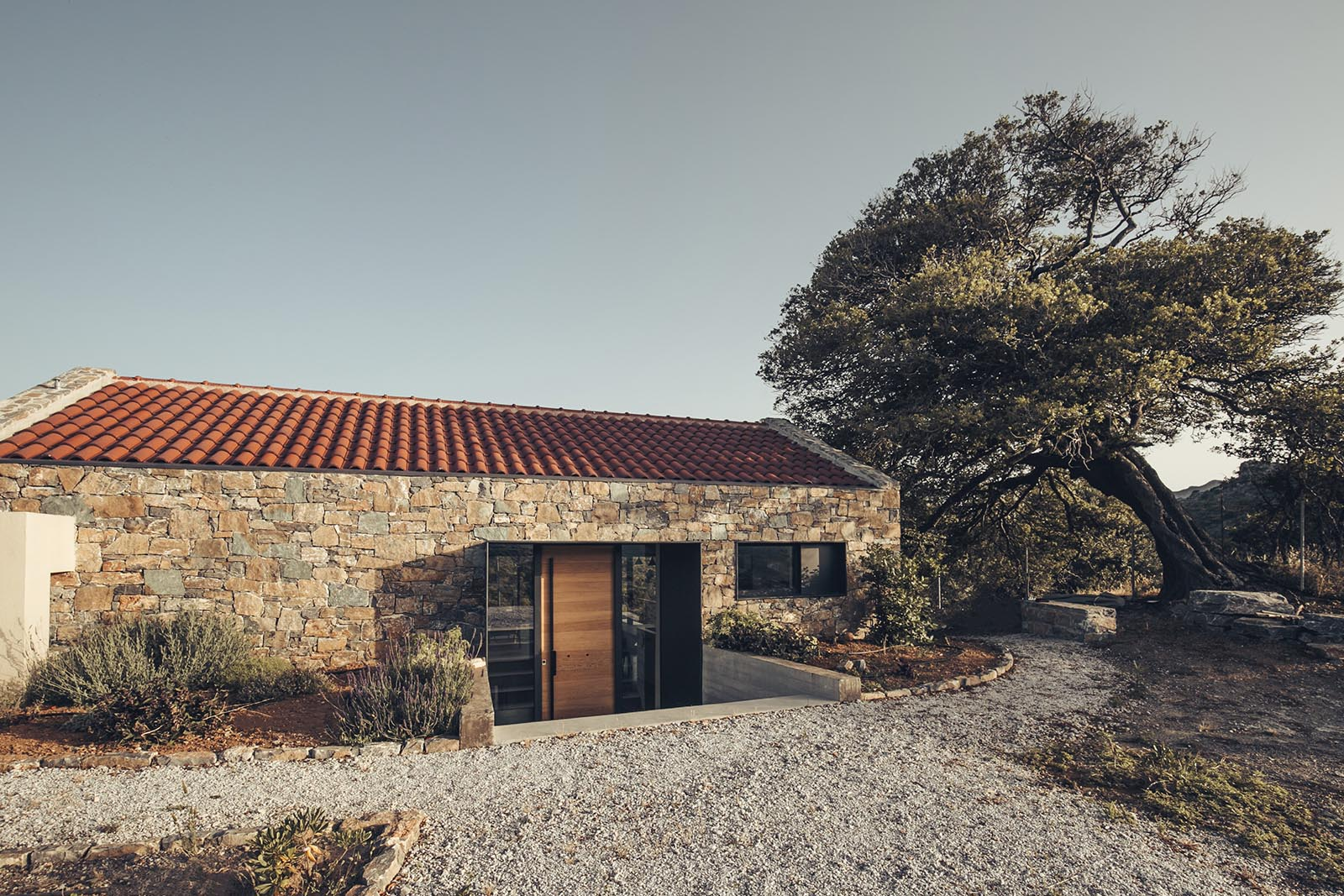 A stone house with black metal accents.