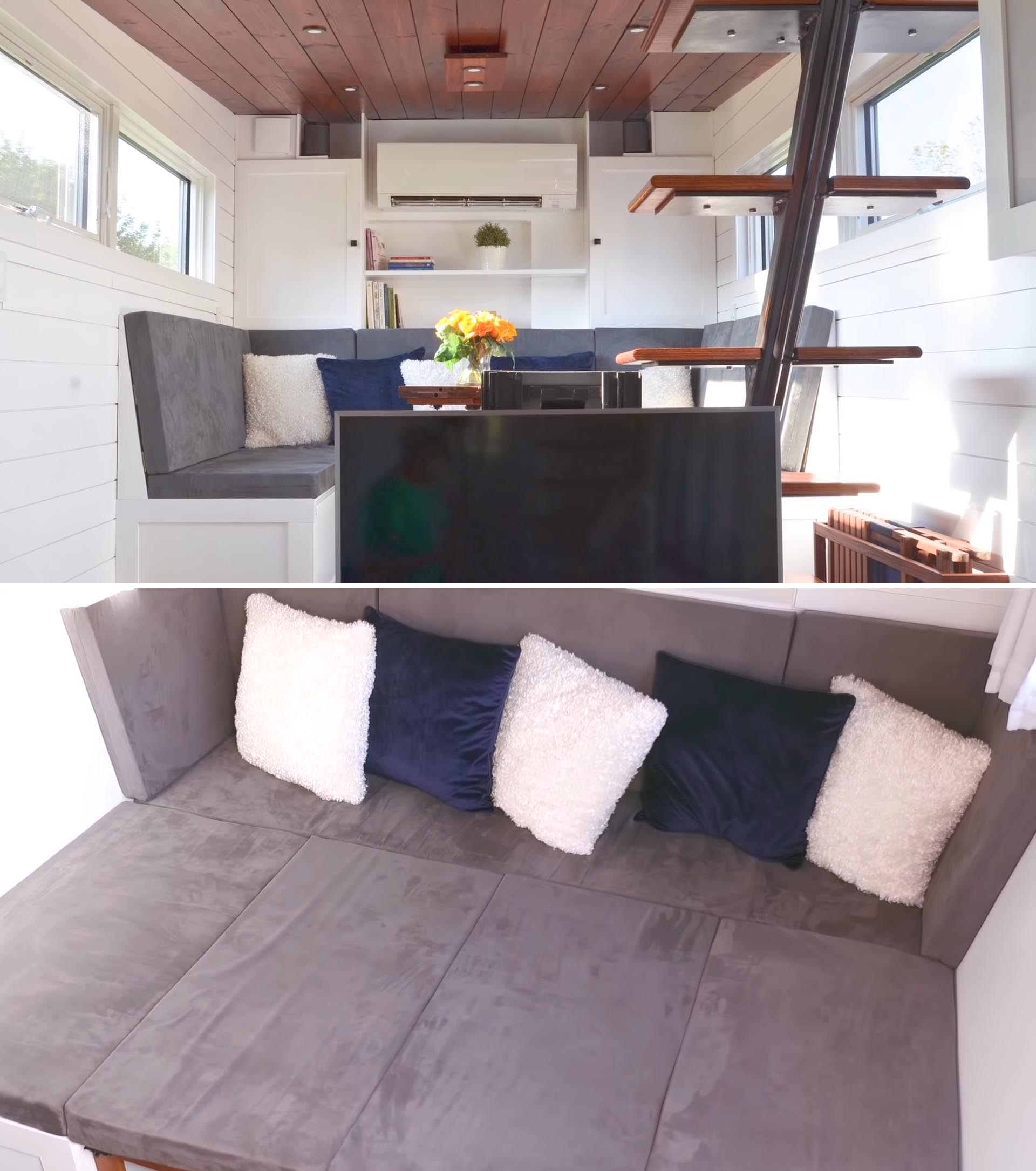 A tiny house living room with a couch that transforms into a queen sized bed.