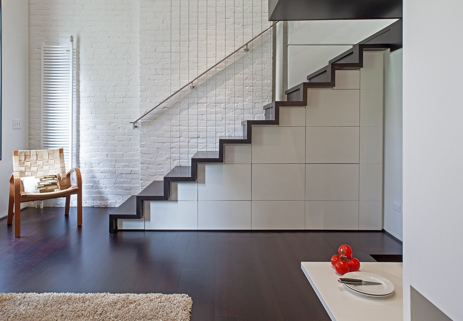Stairs with built-in storage in the form of cabinets and drawers.