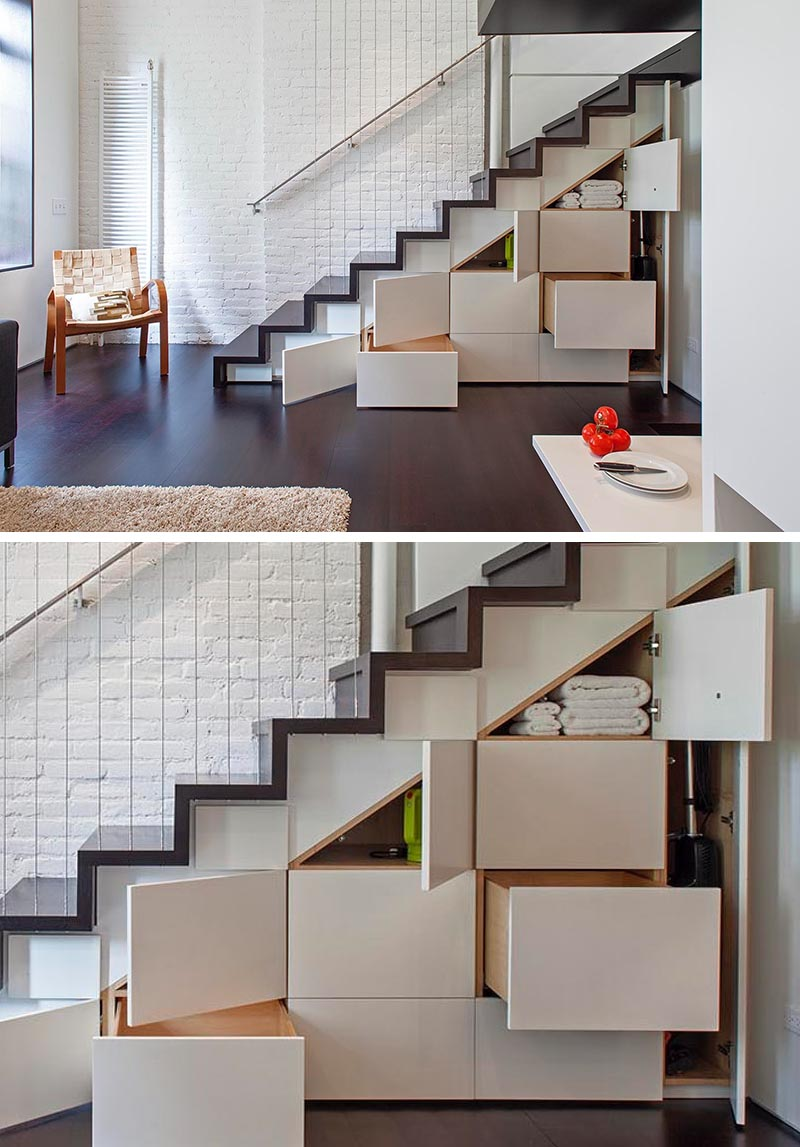 Built-in cabinets and drawers under these stairs add much needed storage to a small apartment.