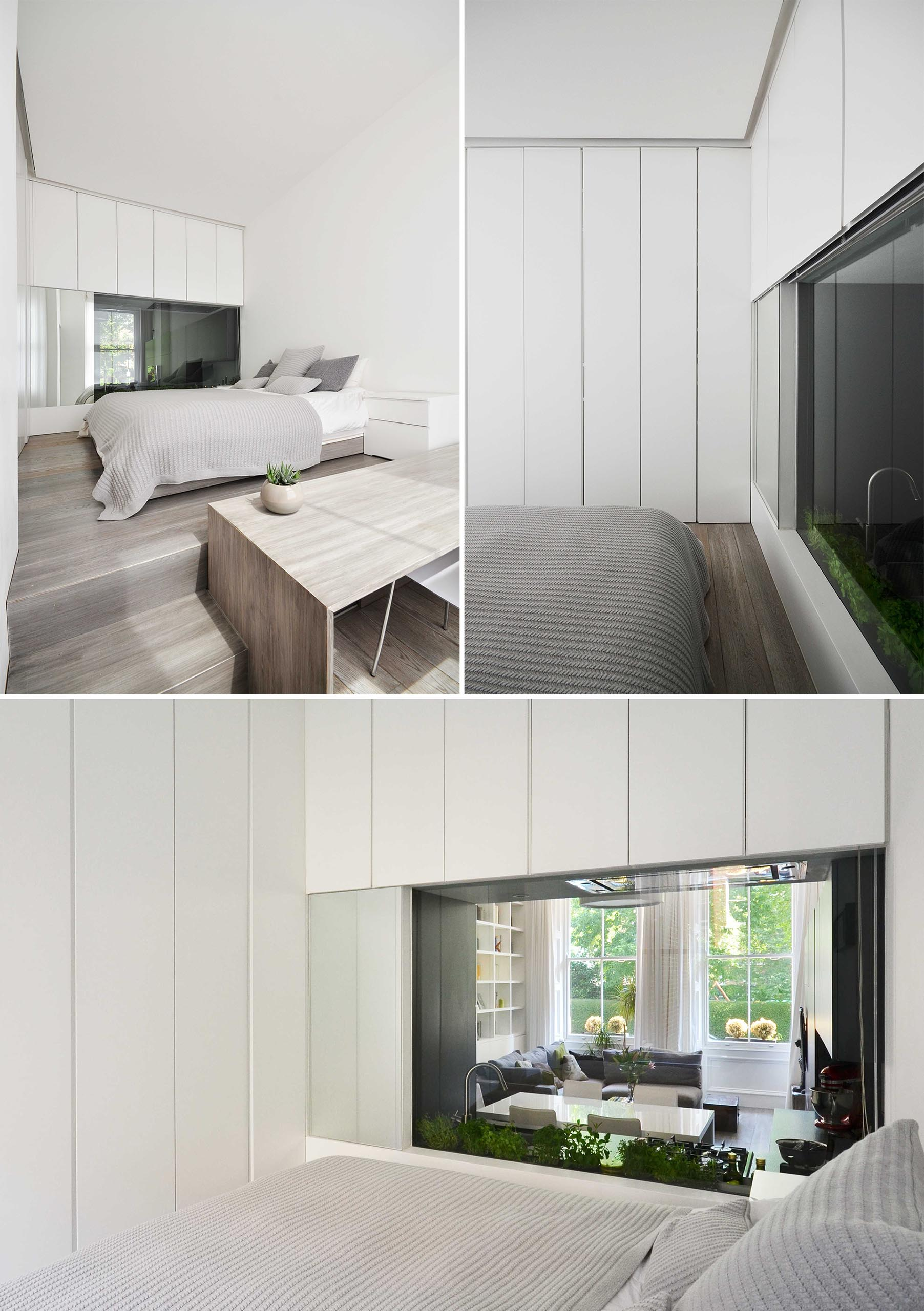 A bedroom with a window that looks through to the kitchen.
