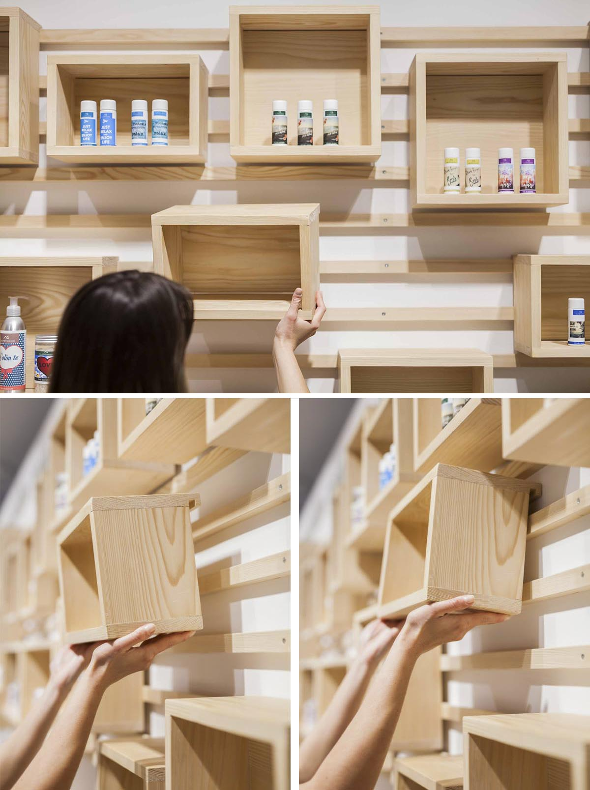 A wall-mounted cleat shelving system with wood boxes.