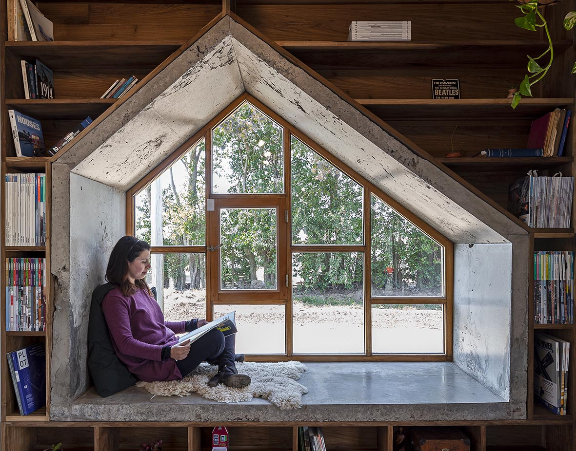 A Deep Window Seat Creates A Reading Space For This Architect's Office