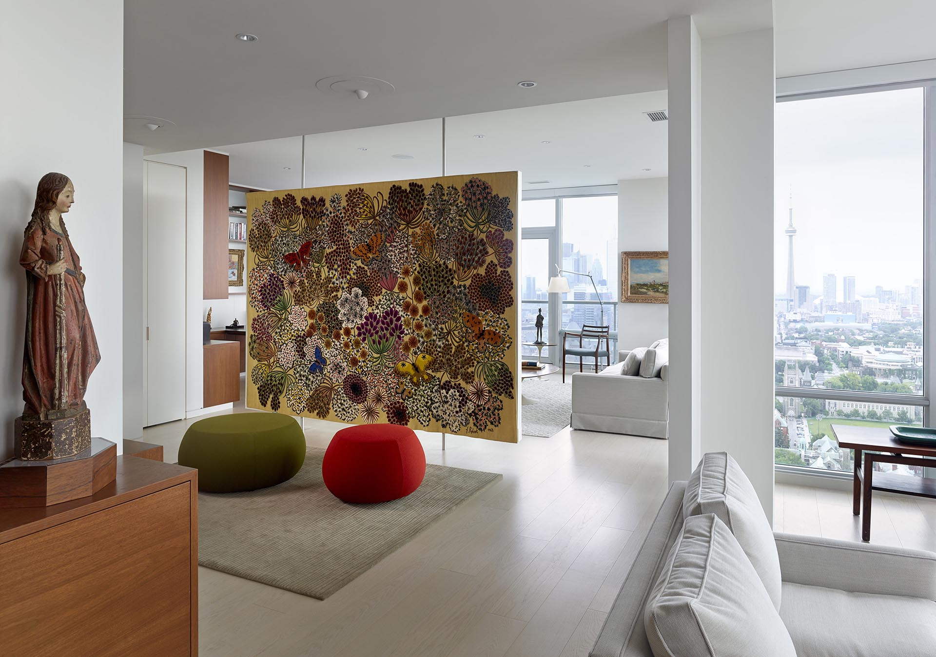 A Floating Room Divider Is Used To Display Artwork In This Apartment