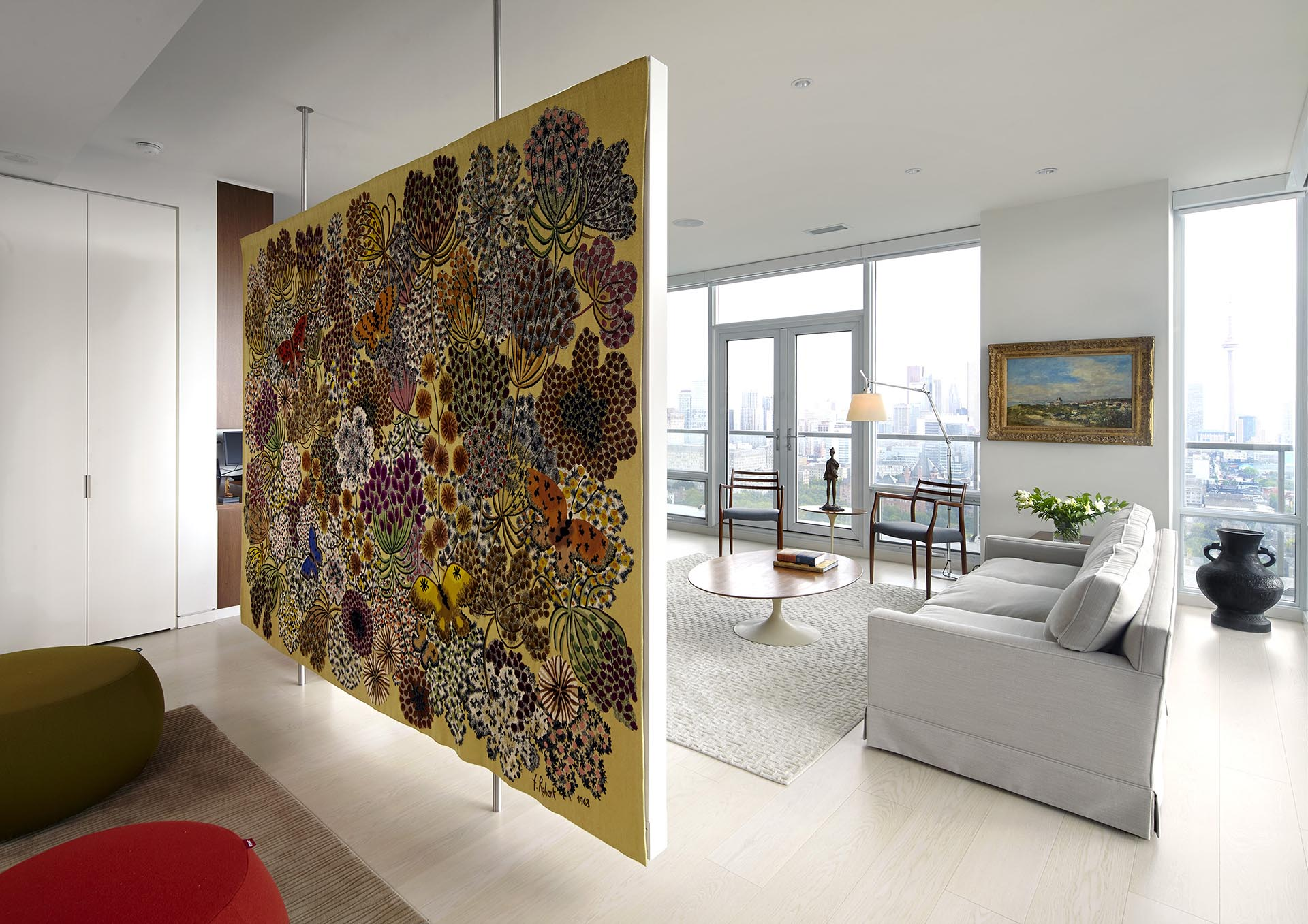 A large floating room divider that's used to display artwork.