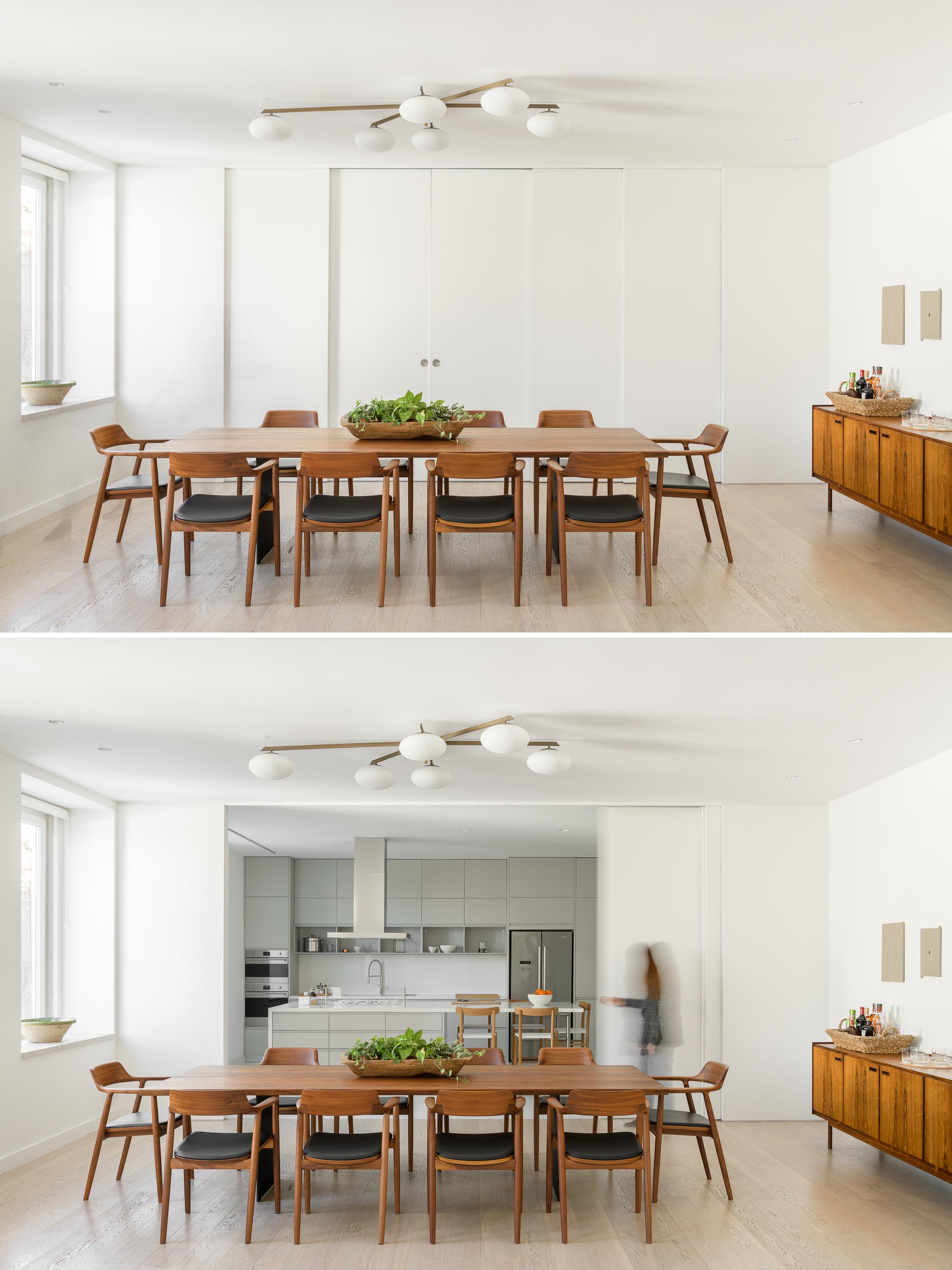 Sliding white panels doors hide the kitchen from the dining room.
