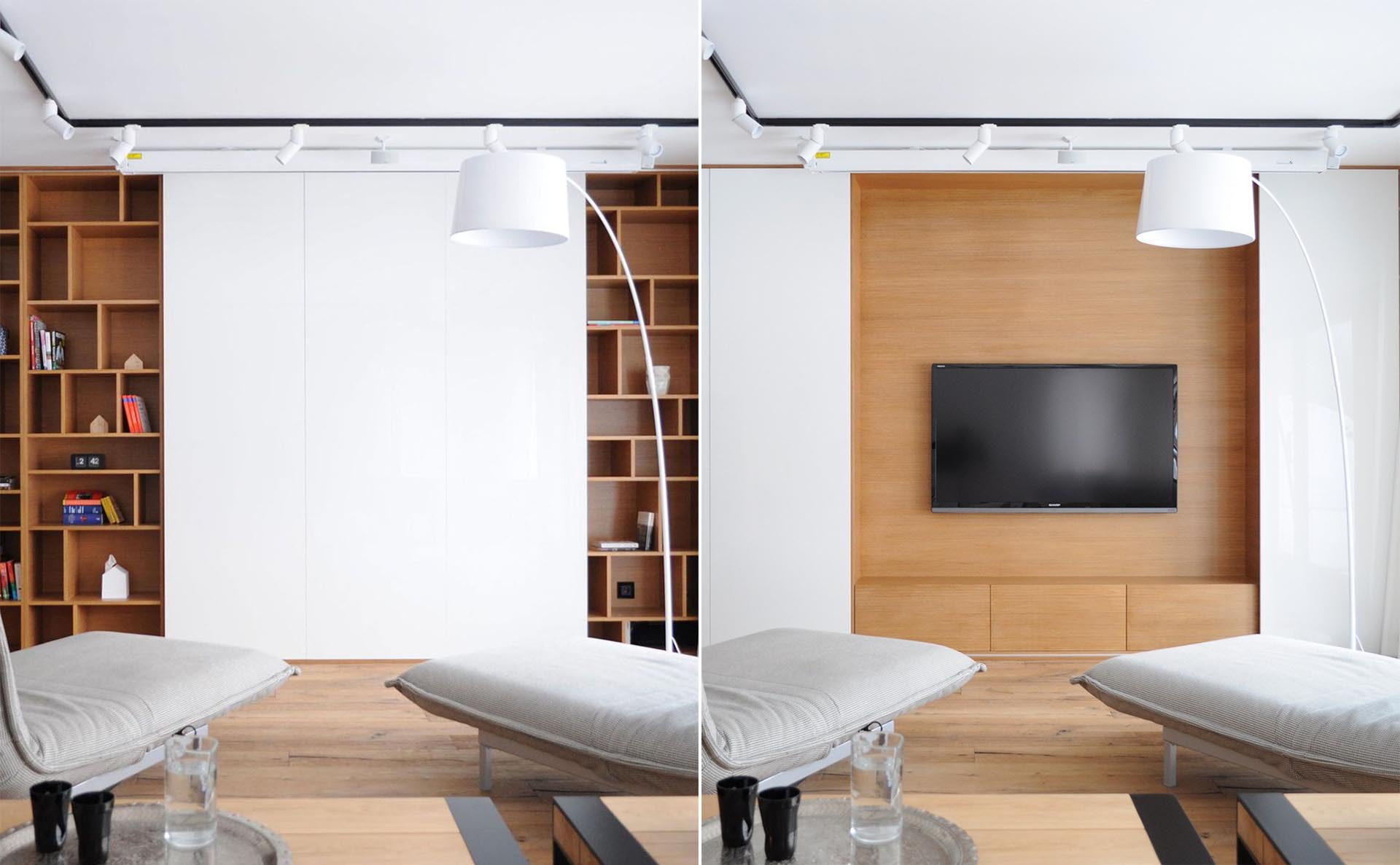 The TV In This Living Room Can Be Hidden Behind Sliding Wall Panels