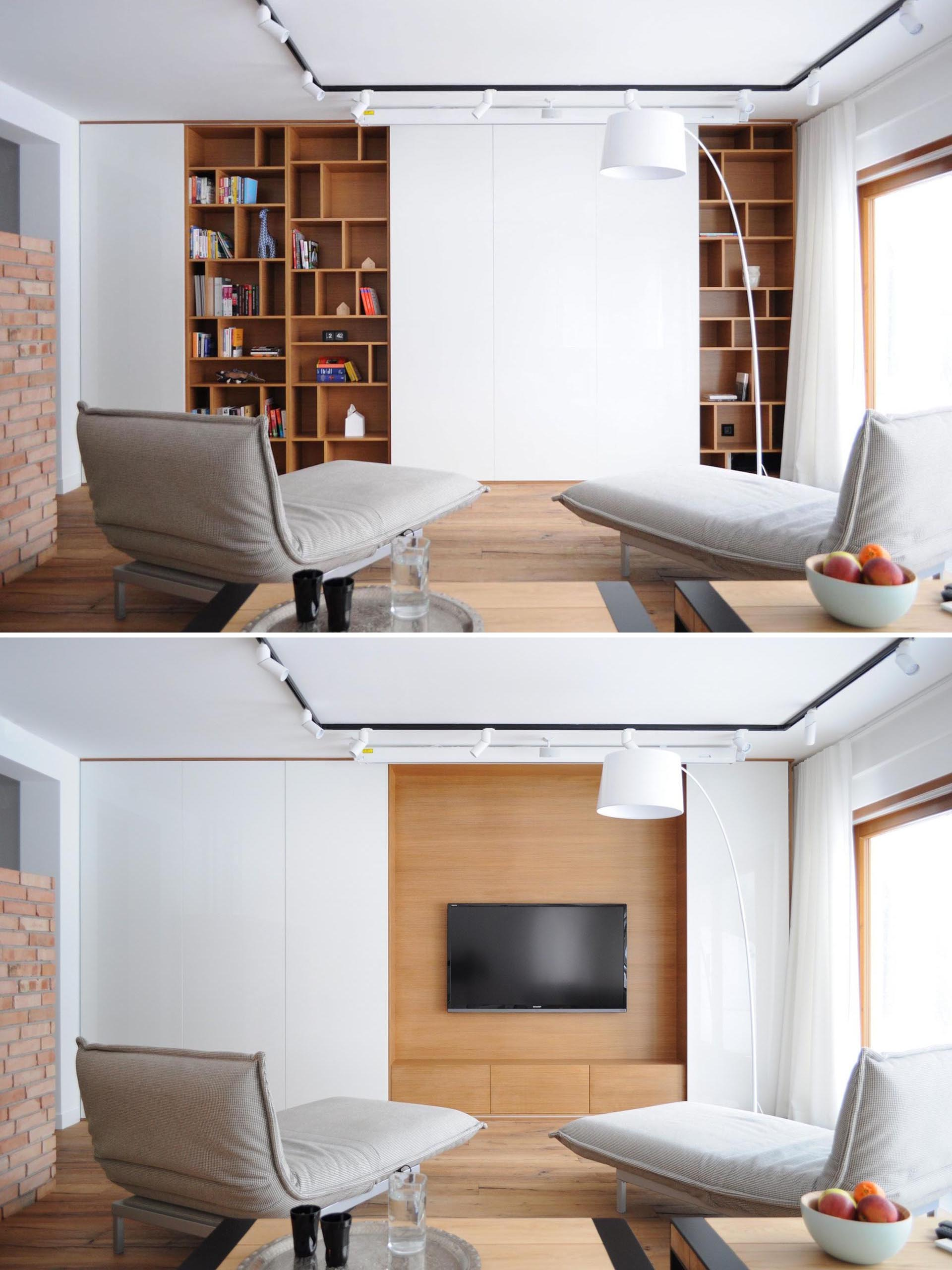 A TV is hidden behind sliding white wall panels.